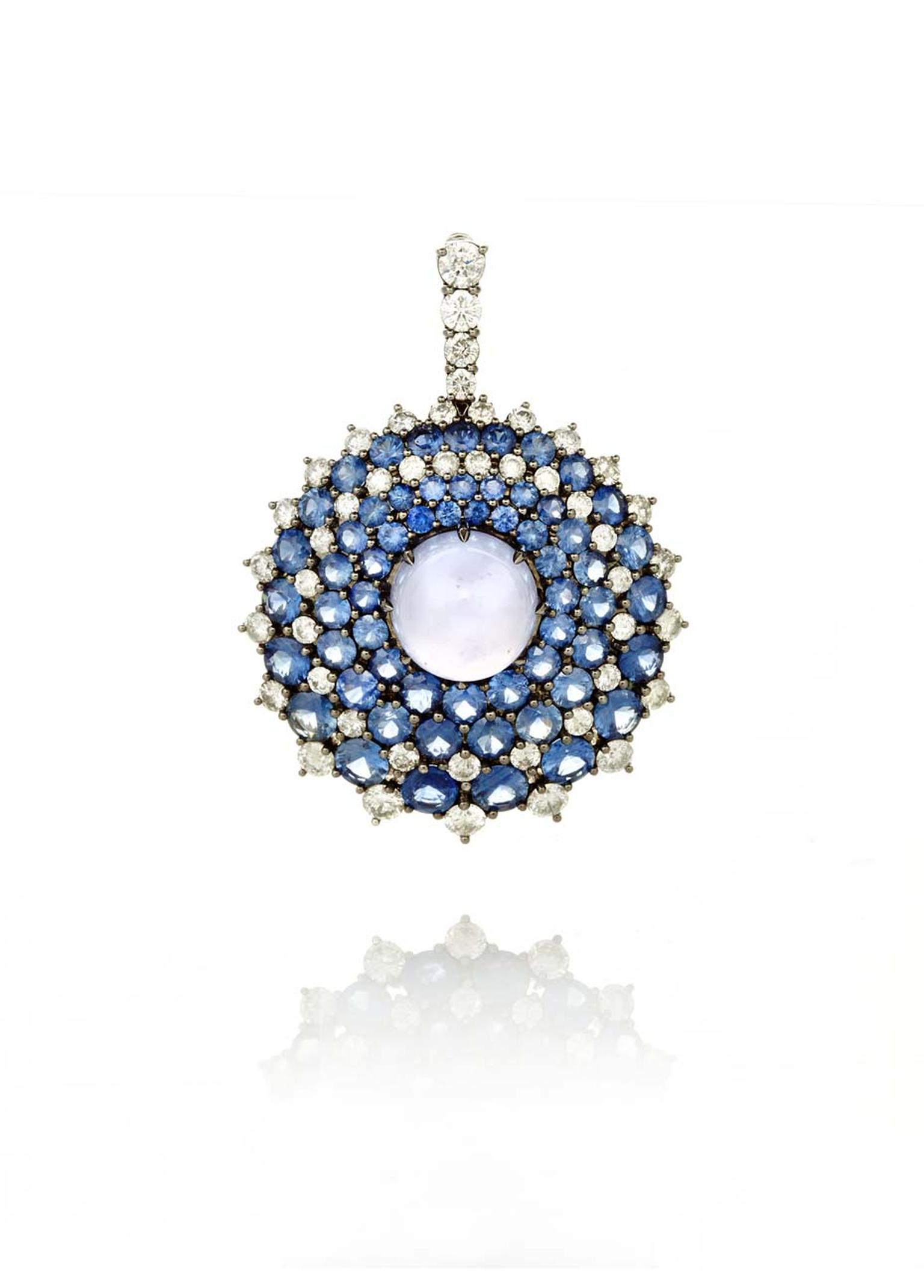 Nam Cho Riviera convertible pendant and pin with a central pastel blue chalcedony orb surrounded by circles of random pavé-set faceted sapphires and diamonds (from $26,500).