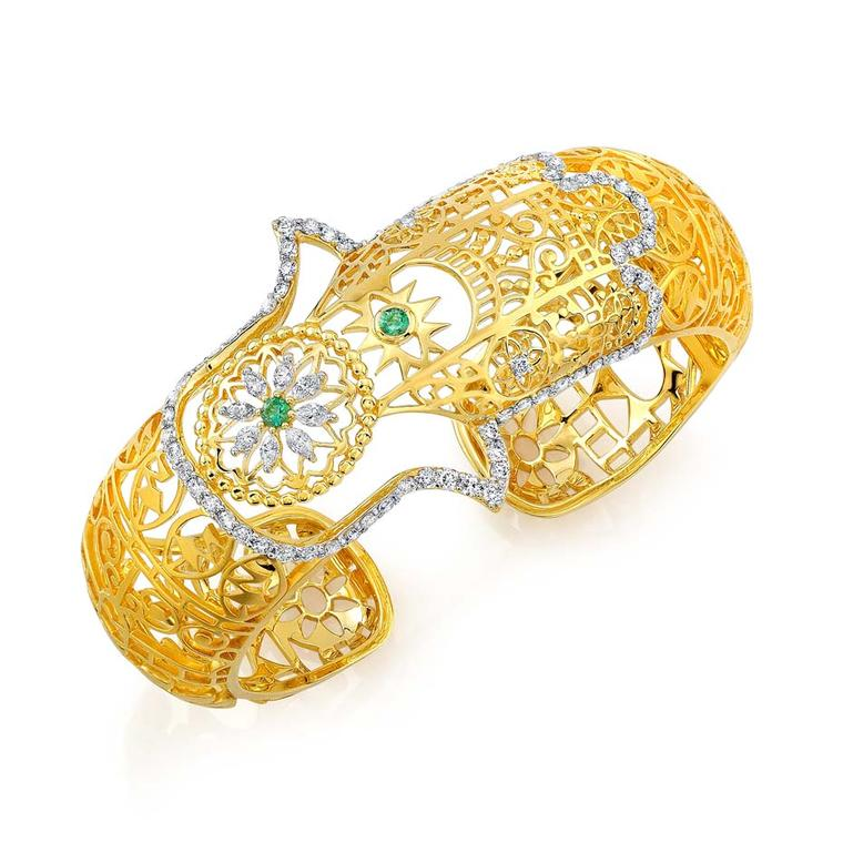 Buddha Mama filigree hinged Hamsa cuff with diamonds and emeralds ($18,400).