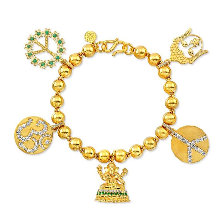 Buddha Mama Auspicious charm bracelet in gold with diamonds and emeralds ($19,000).