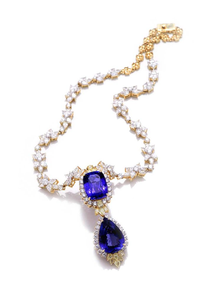 Farah Khan classic diamond necklace with cushion-shaped and pear-shaped tanzanite accented by yellow sapphires set in yellow gold.