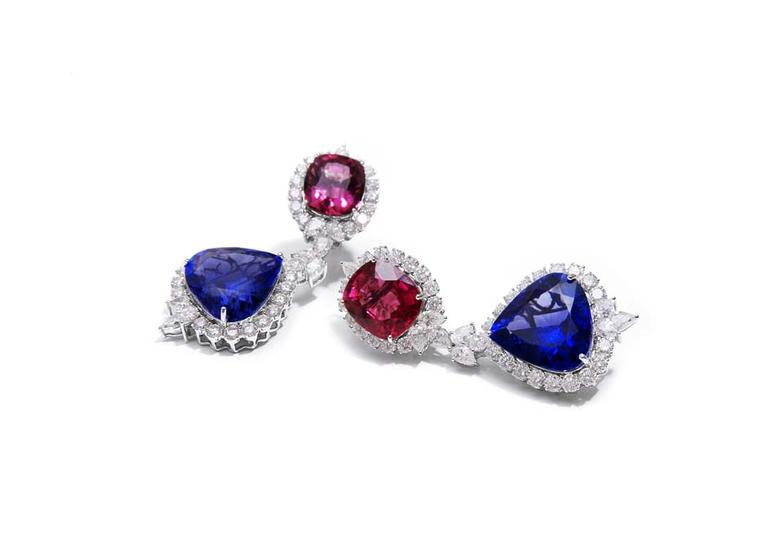 Farah Khan rubellite and tanzanite earrings surrounded by diamonds.