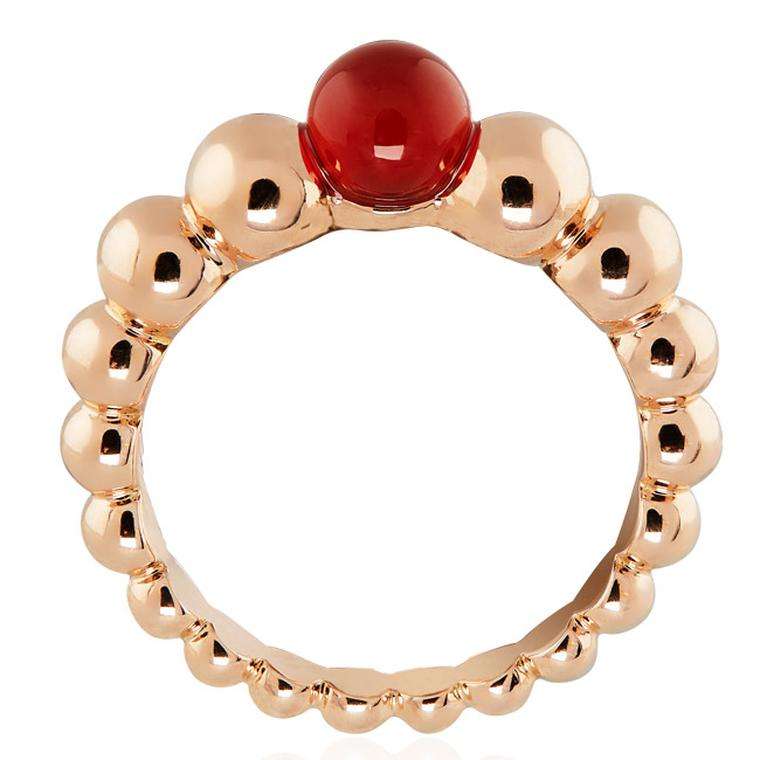 Van Cleef & Arpels Perlée Couleurs rose gold ring, set with a vivid red cornelian gemstone at the crown (£1,550).
