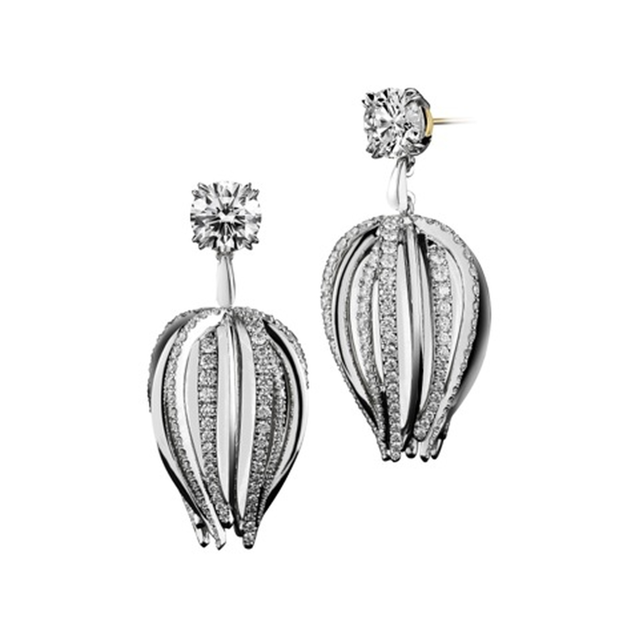 Alexandra Mor curved dangling diamond earrings set in white and black gold.