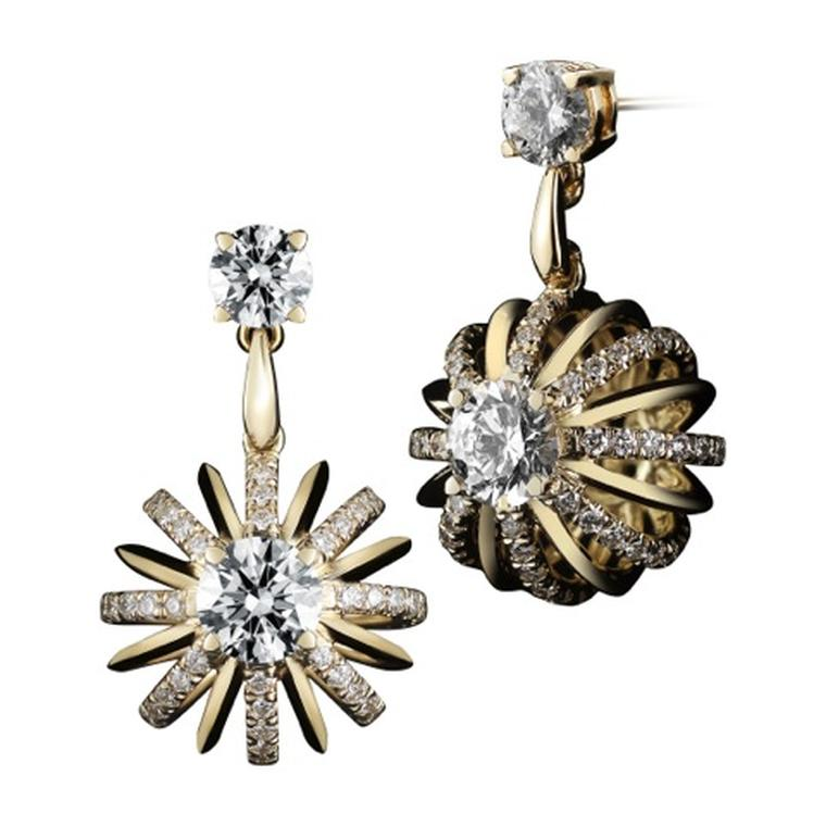 Alexandra Mor yellow gold Dangling Snowflake earrings with diamonds.
