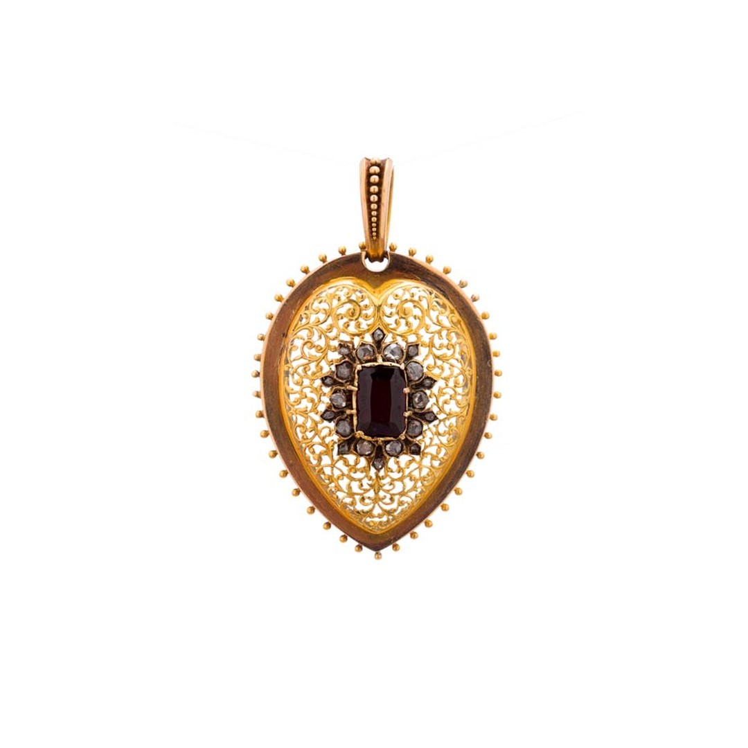 Broken English vintage heart locket in yellow gold  with a center garnet and white diamonds ($6,400).