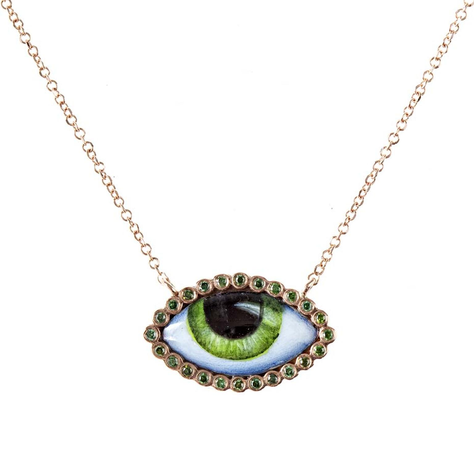 Lito Her Tu Es Partout necklace in rose gold featuring a green enamelled eye surrounded by green diamonds ($1,070).