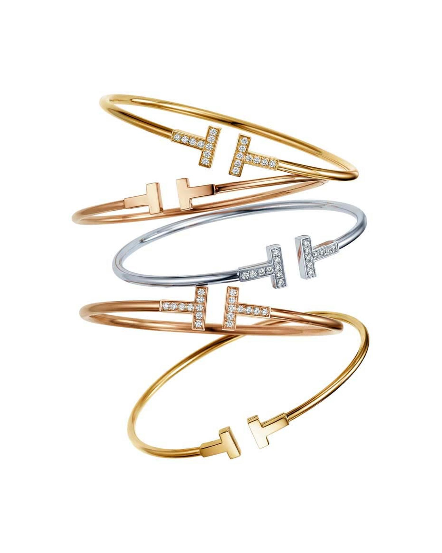 Two graphic diamond-studded T's accentuate the simple lines of the Tiffany & Co. Tiffany T collection wire bracelets, available in white, yellow and rose gold, with or without diamonds.