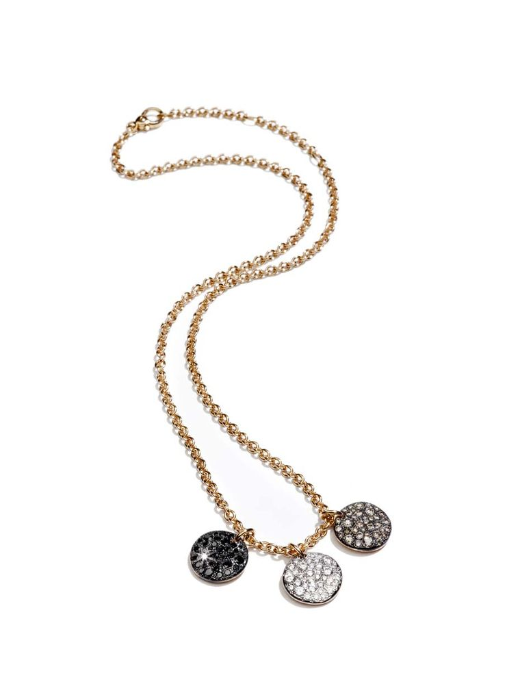 Pomellato Sabbia pendant with three rose gold discs set with black, white and brown diamonds.