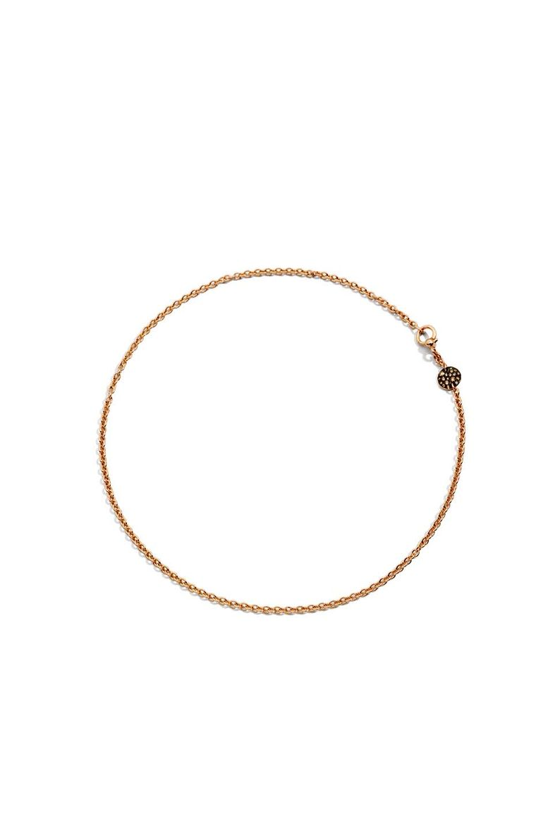 Pomellato Sabbia choker necklace featuring a rose gold disc set with brown diamonds.