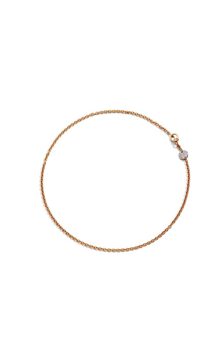 Pomellato Sabbia choker necklace featuring a rose gold disc set with white diamonds.