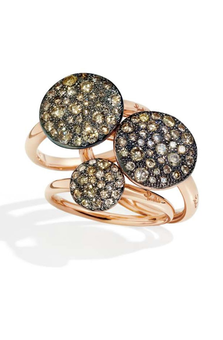 Pomellato Sabbia rings in rose gold, set with white, black or brown diamonds in a random pattern that mimics the sun on sand.