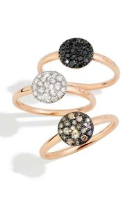 Pomellato Sabbia rings in rose gold with black diamonds, white diamonds and brown diamonds.