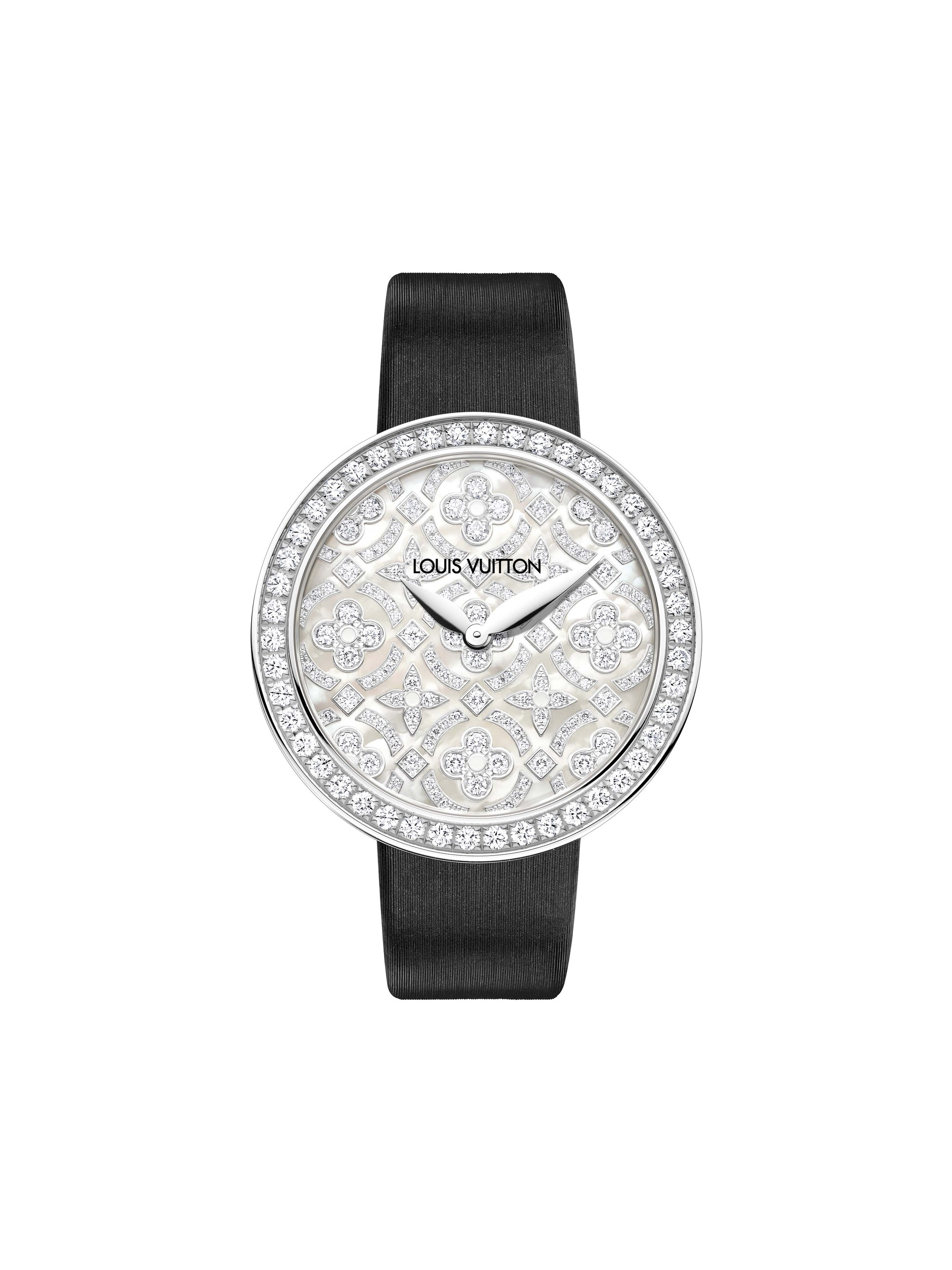 Louis Vuitton Dentelle de Monogram watch in white gold featuring an engraved white mother-of-pearl dial with the Louis Vuitton flower motif set with diamonds.