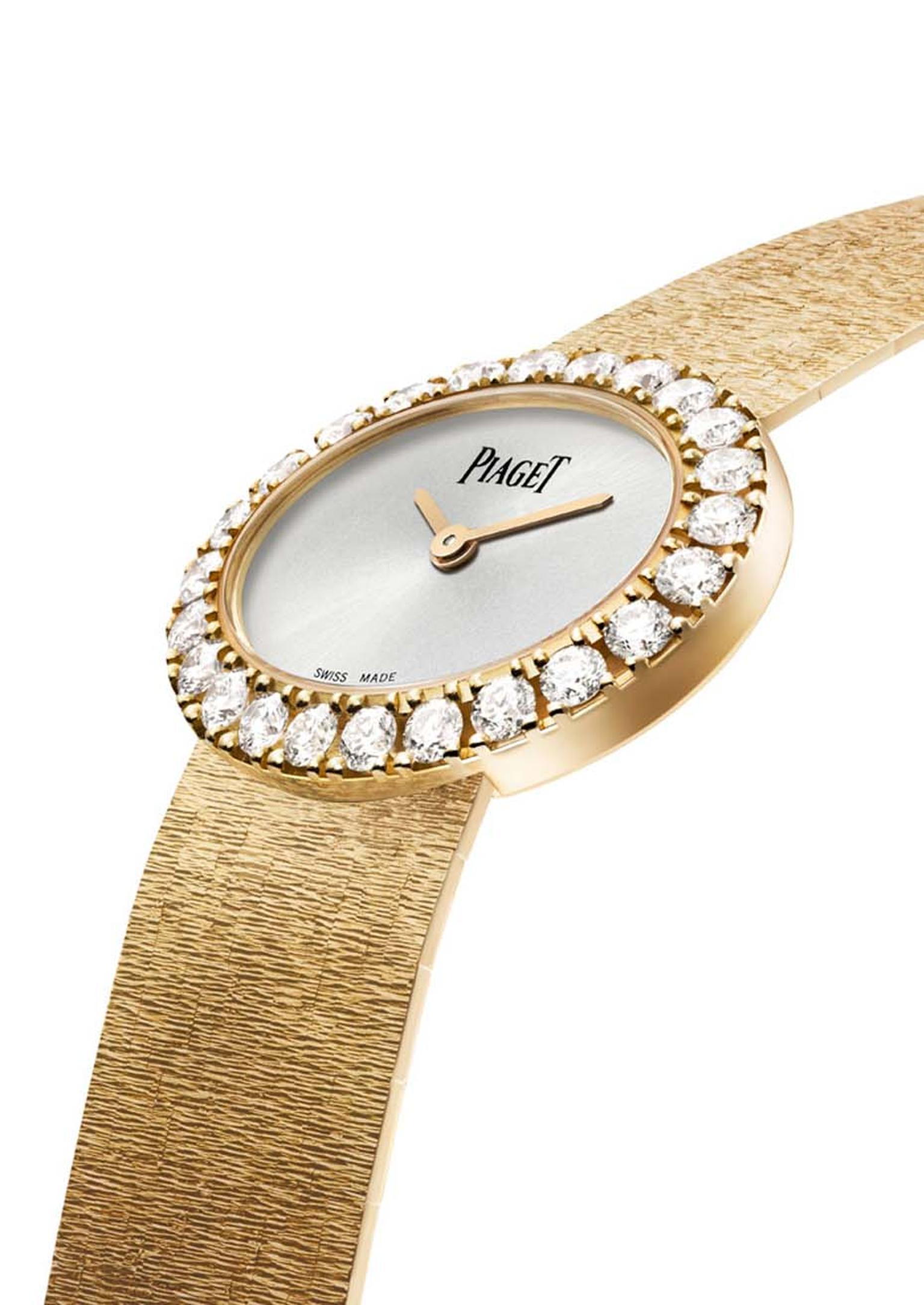 The slim case of the Piaget Gold Oval watch features a diamond bezel surrounding an uncluttered soft silver tone dial.