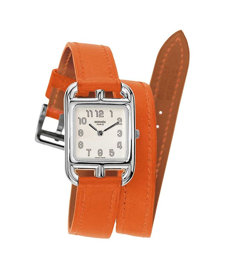 The Hermès Cape Cod Tonneau GM Silver watch is made in Hermès' new patented silver alloy, with a super soft and supple burnt orange Hermès leather strap that wraps twice around the wrist (£2,400).