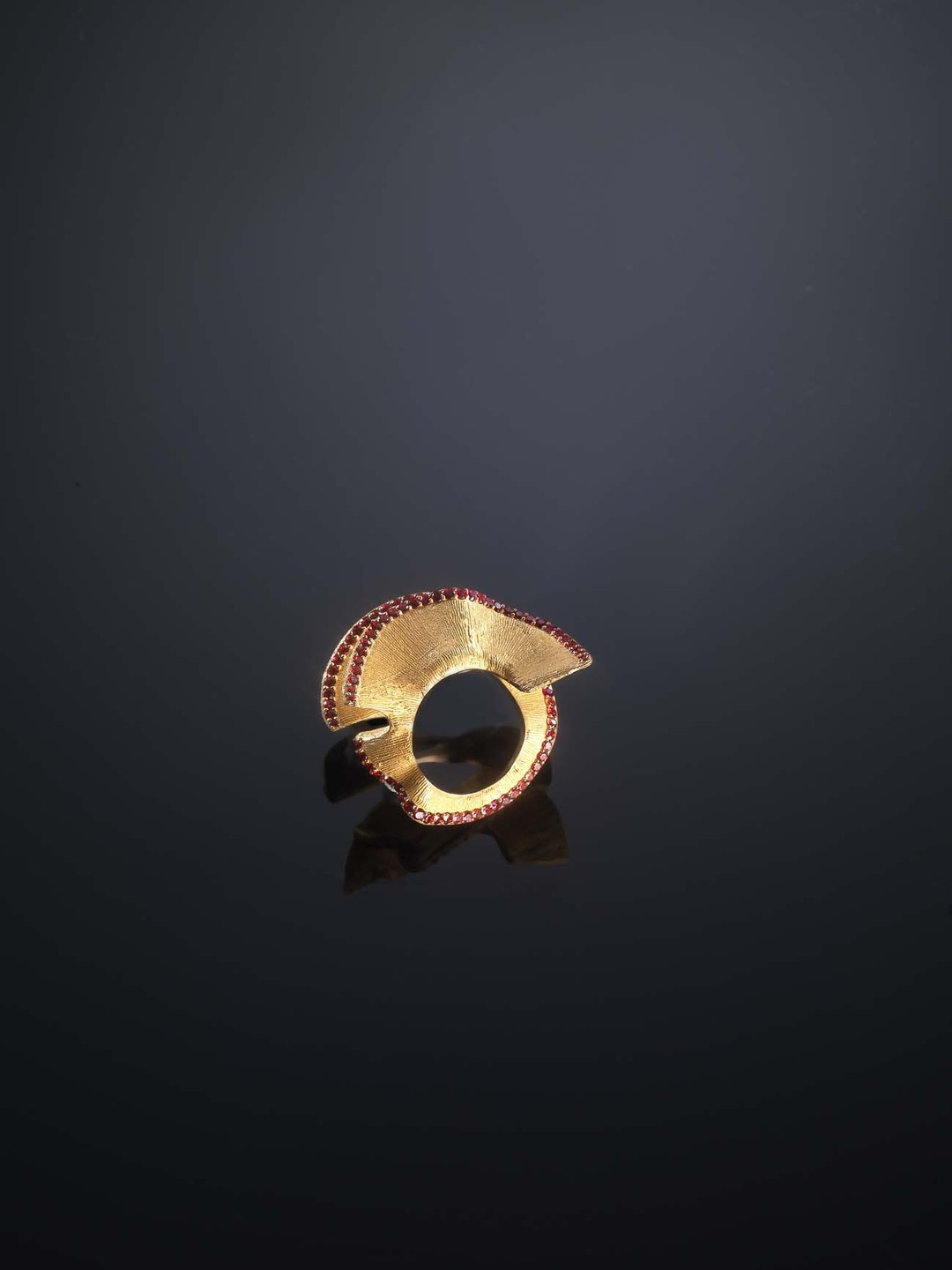 Gold ring from the Luz Camino Pencil Shavings collection with fire sapphires.