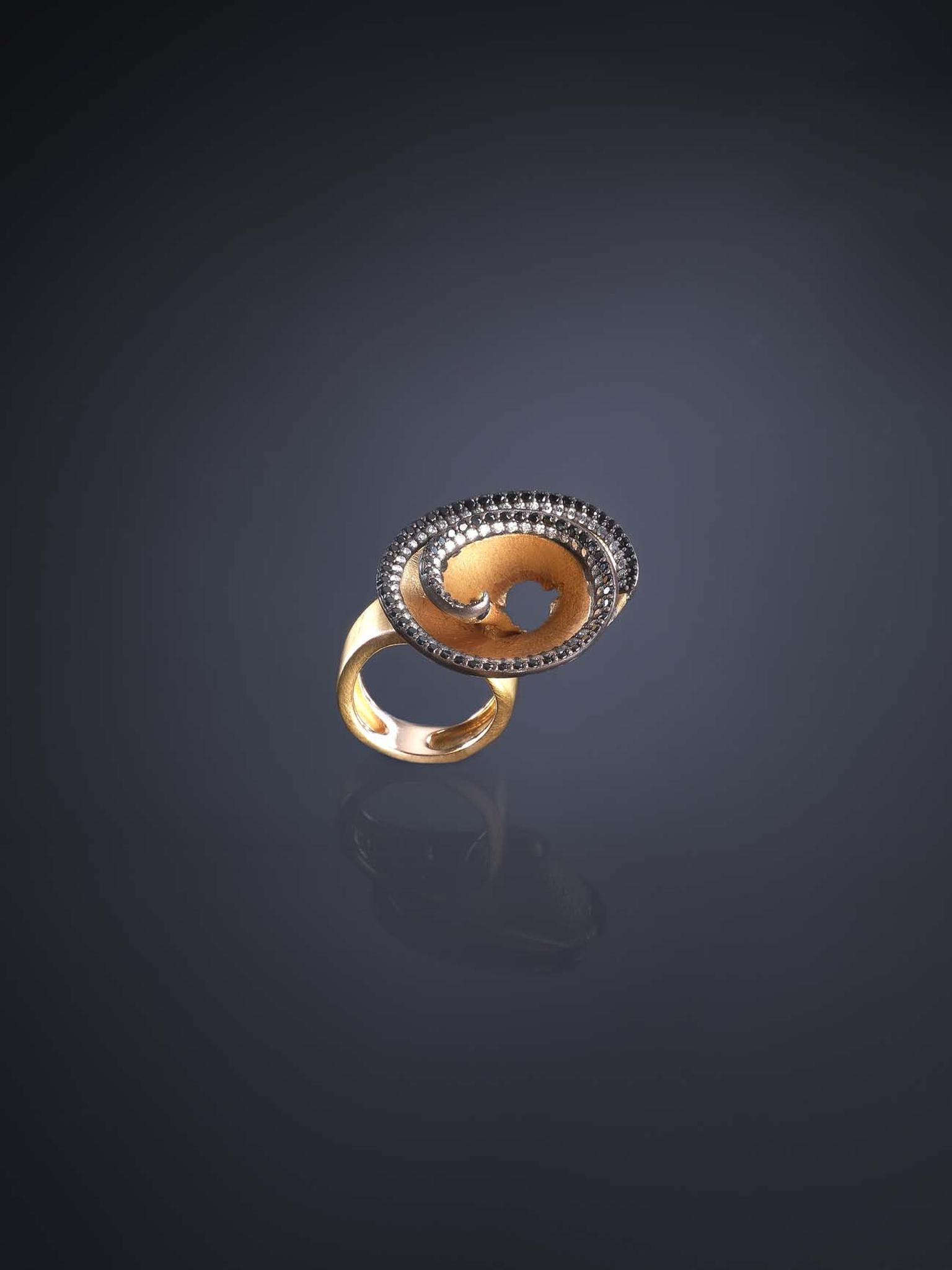 Gold ring from the Luz Camino Pencil Shavings collection with spinels and diamonds.