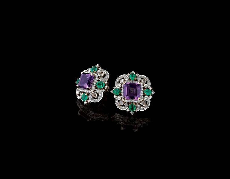 Farah Khan for Tanishq amethyst stud earrings surrounded with emeralds and diamonds set in yellow gold.