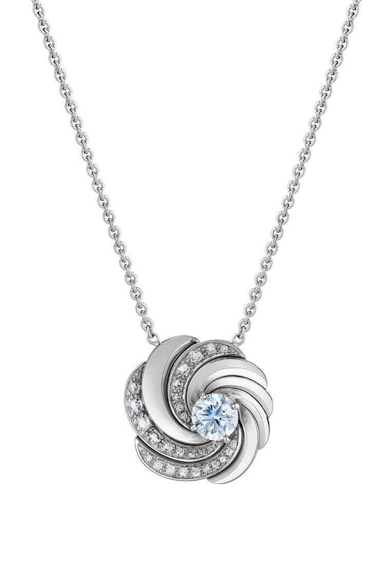 De Beers Aria necklace featuring a round brilliant diamond sitting at the centre of swirling ribbons of white gold and diamond pavé (£8,750).