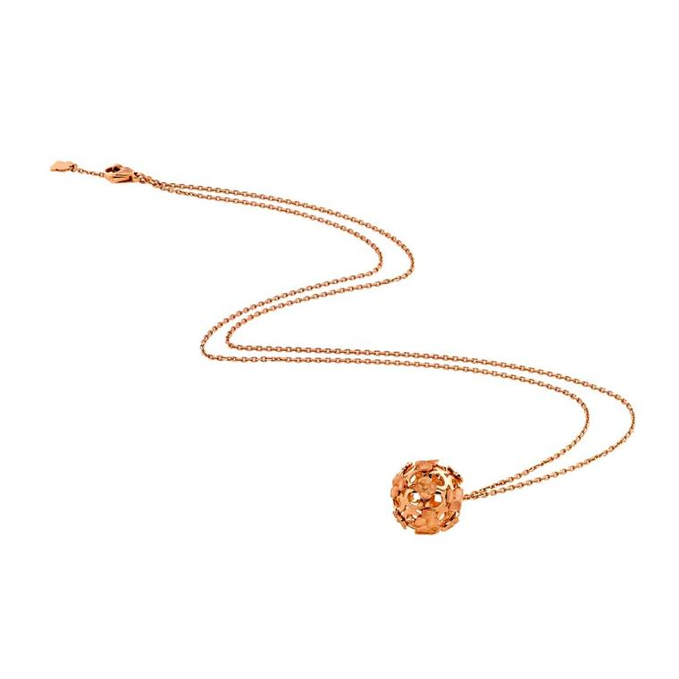 The Chaumet Hortensia necklace hangs fashionably low on a long chain with interlaced rose gold flowers fashioned into a ball, inspired by the round shape of the hydrangea flower (£2,030).