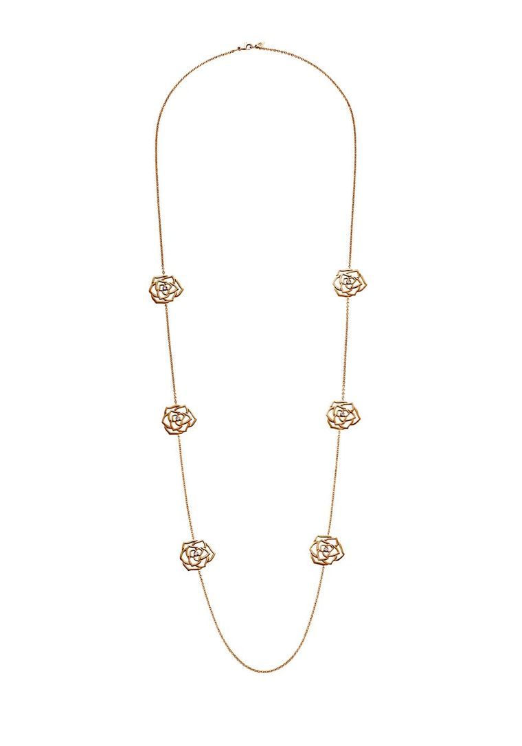 Piaget Rose necklace in rose gold. Measuring over a metre in length, it features six symmetrically placed roses with a diamond nestling in the centre of each (£6,600).