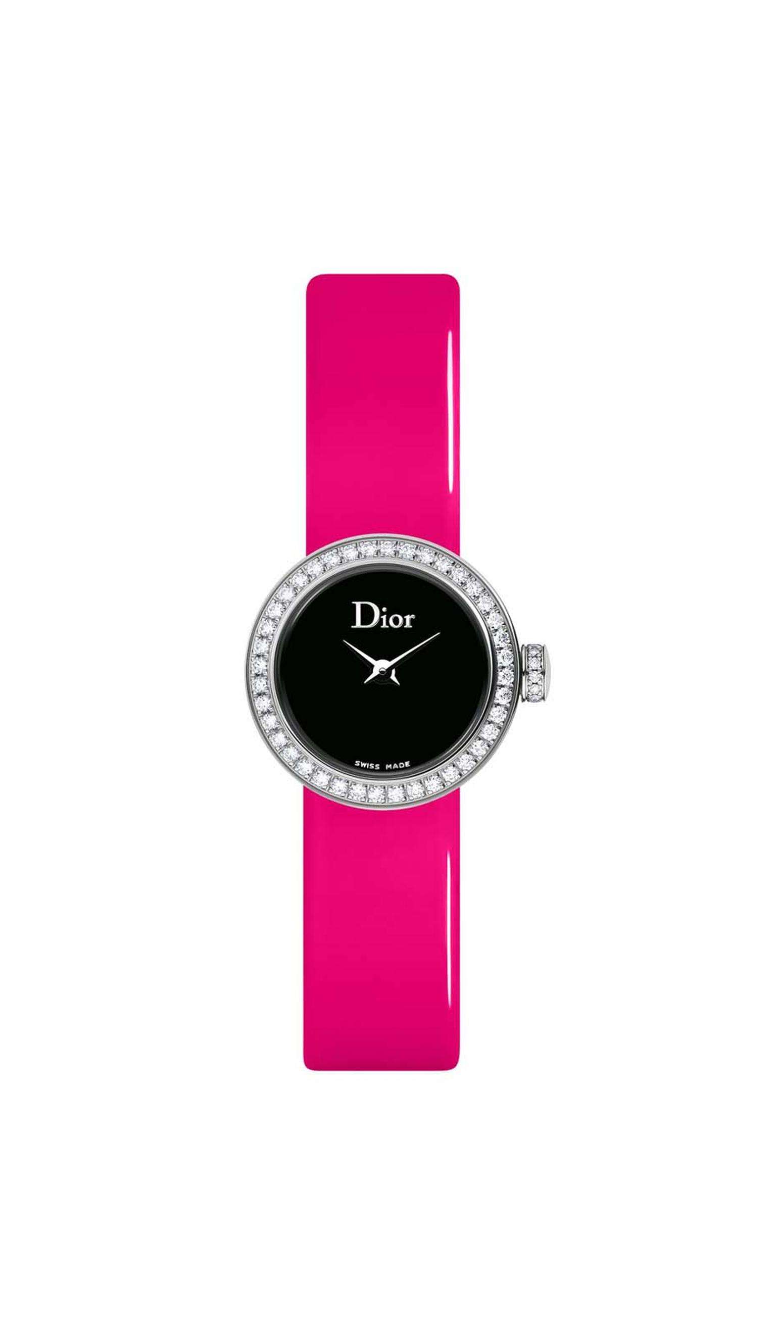 La Mini D de Dior watch with an inky black mother-of-pearl dial set alight with diamonds on the bezel and crown and a fluoro pink strap (£2,900).