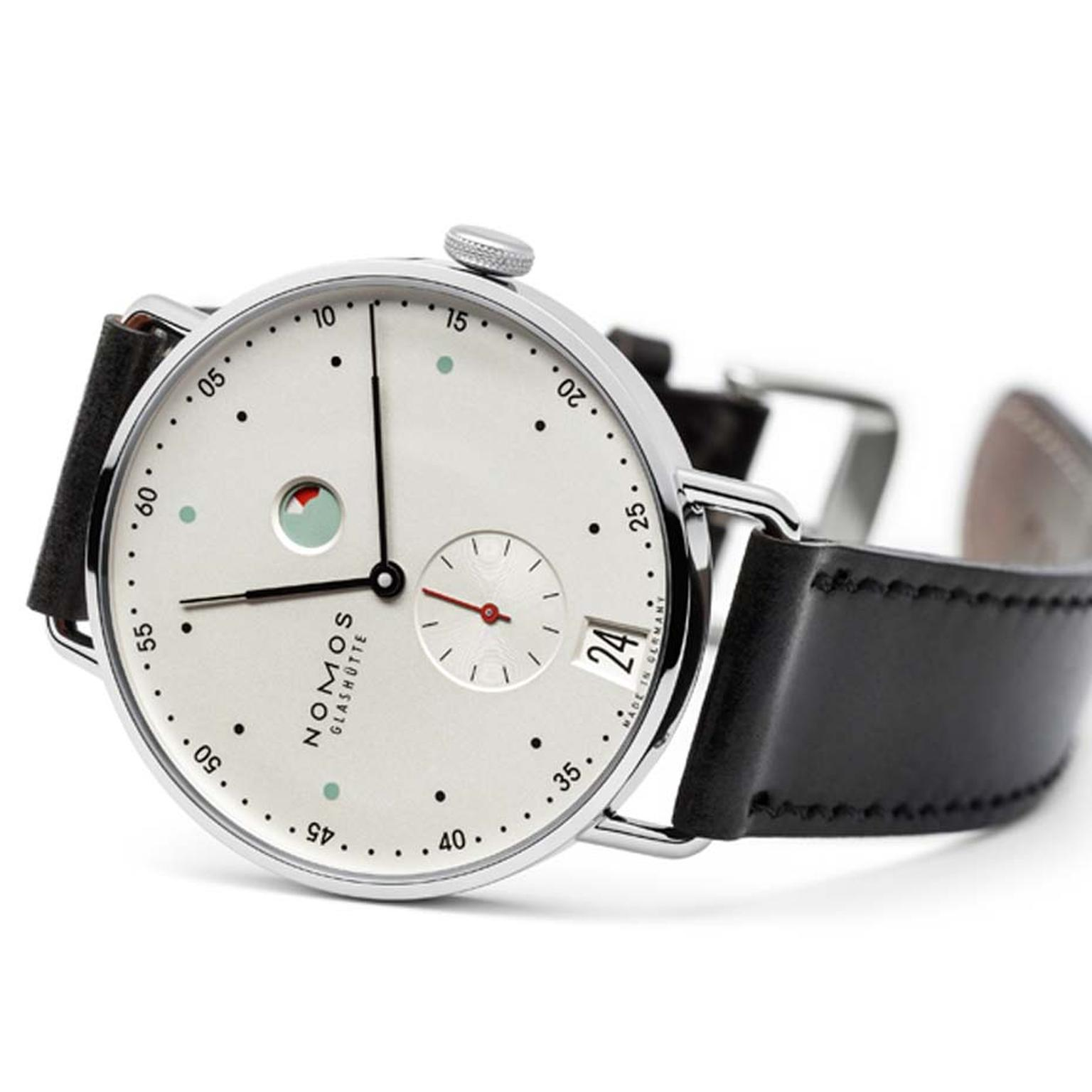 With a minimalist Bauhaus aesthetic, the dial of this Nomos Metro watch, with its date window, power reserve and small seconds counter, incorporates touches of colour to great effect (£2,390).