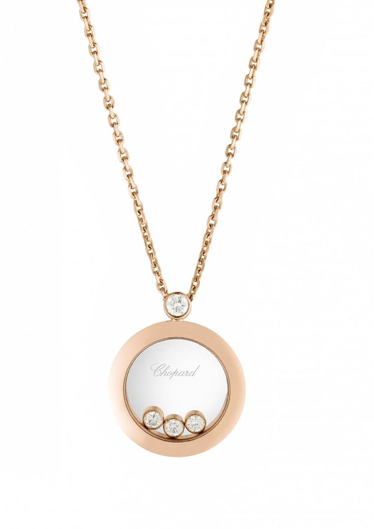 Chopard Happy Diamonds pendant in rose gold featuring three mobile diamonds in a circular disc suspended from a chain with one static diamond (£2,570).