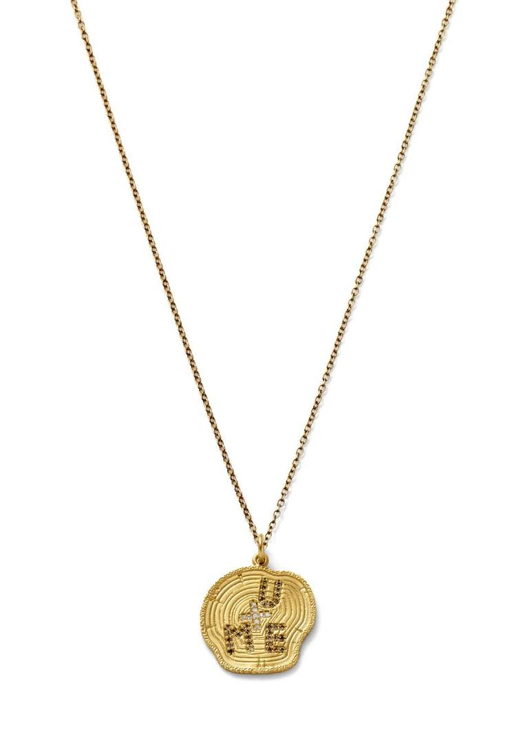 Alison Lou gold U + ME Tree Carving necklace featuring a pavé-set champagne diamond 'U' and 'ME', and pavé white diamond '+'. Available from Latest Revival ($2,490).