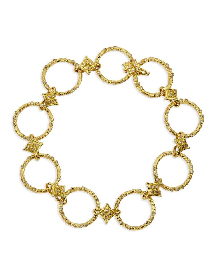 Armenta yellow gold bracelet with textured circle links and quatrefoil stations with pavé white diamonds. Available from Bergdorf Goodman ($4,790).