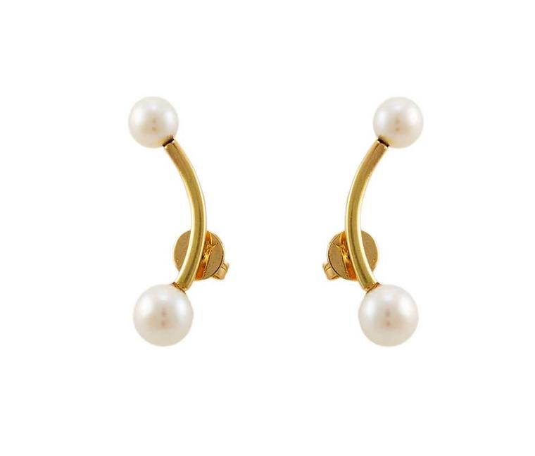 Ana Khouri pearl earrings in gold.