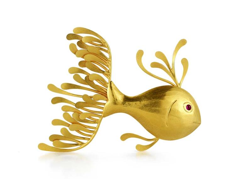 McTeigue & McClelland Flora Fish pin made in yellow gold with a cabochon ruby eye ($4,700).