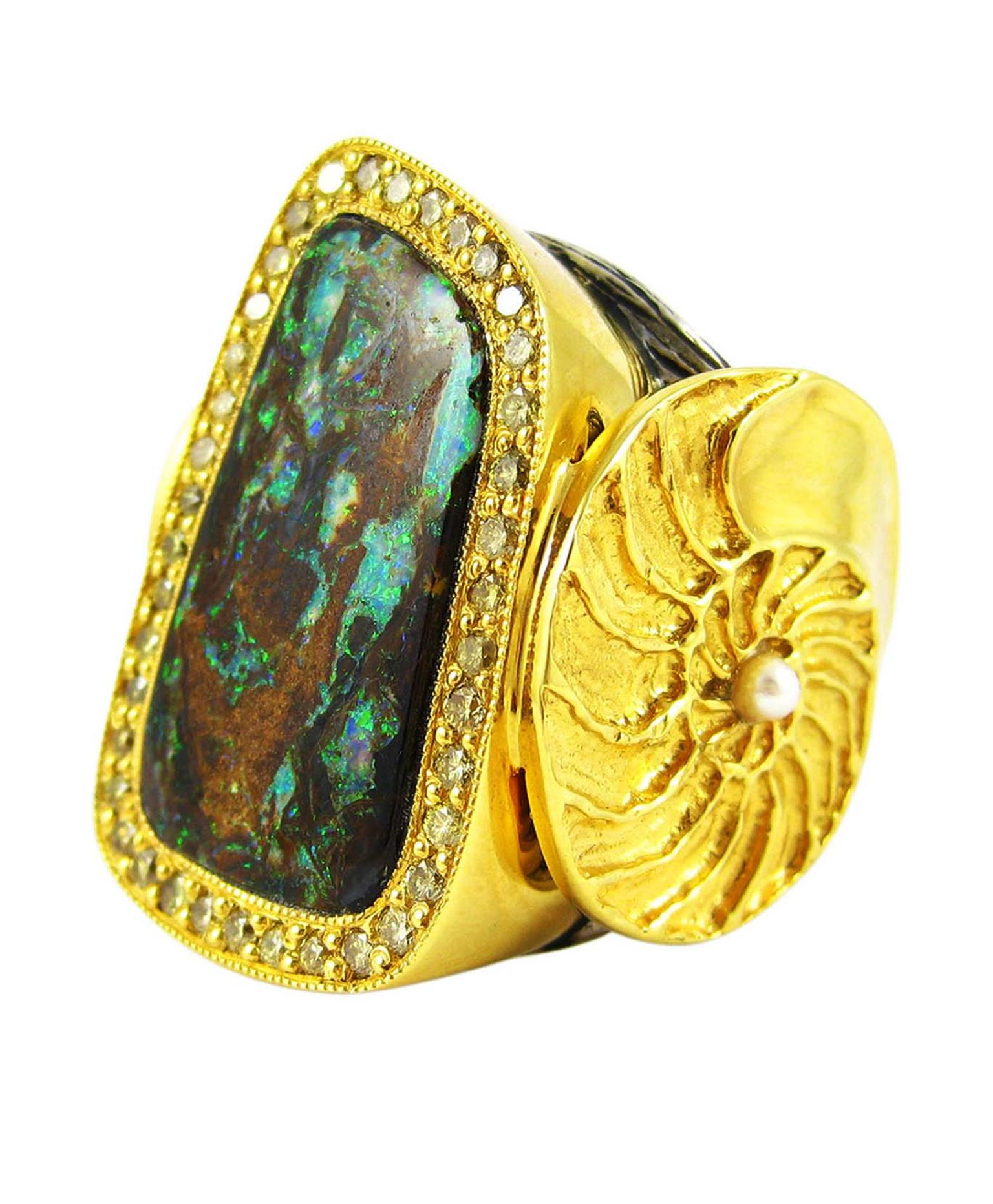 K. Brunini Objects Organique ring in gold and silver with an opal surrounded by diamonds.