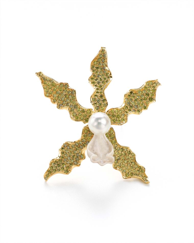 K. Brunini Objects Organique orchid pink in yellow gold with 15.88ct green diamonds, a carved bone trumpet and a South Sea Pearl.