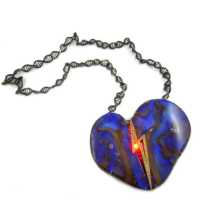 "The K. Brunini Robot Heart opal necklace literally ""beats"", coming alive with a flash of red and a lightning bolt of orange diamonds lit by LED technology."