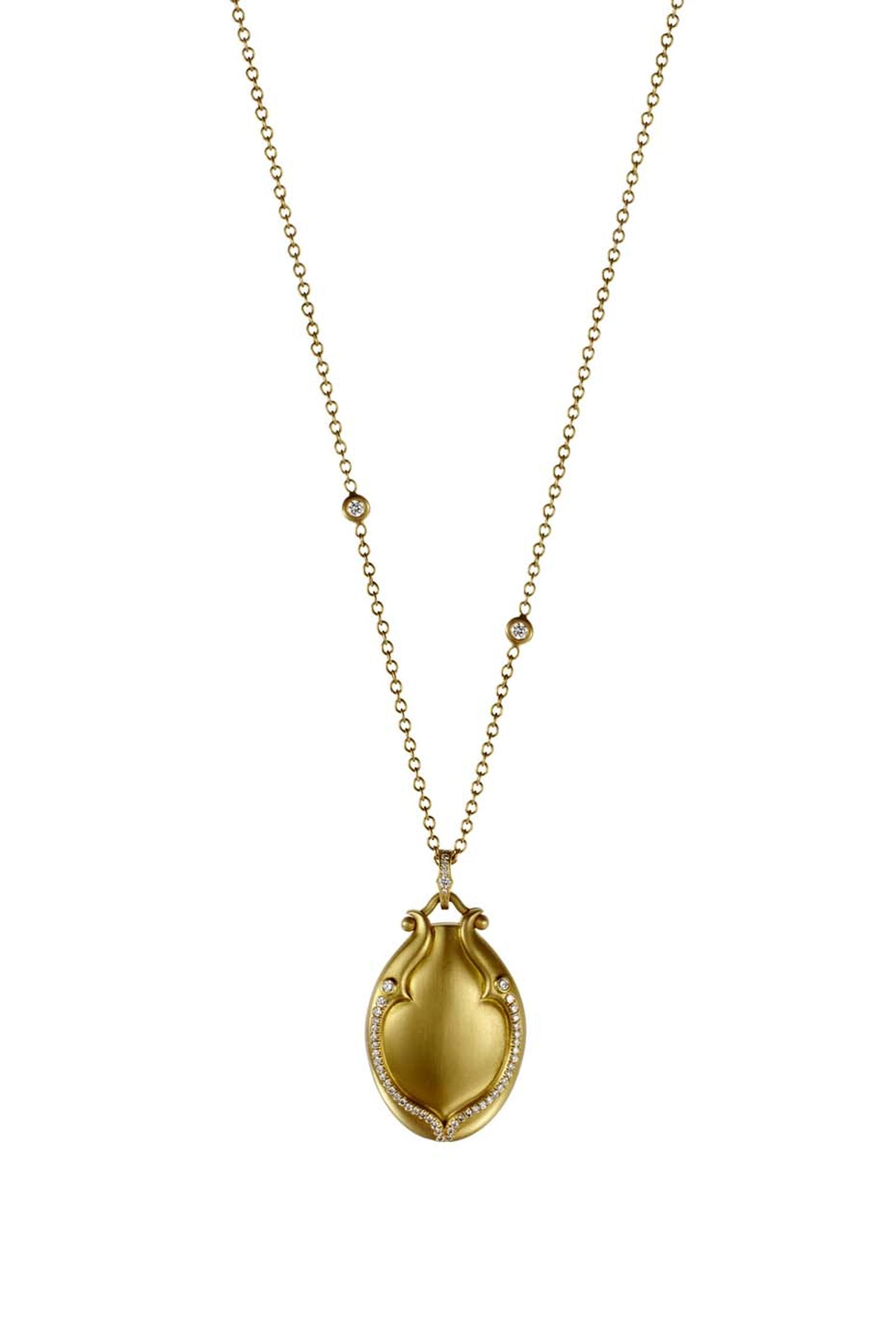 Anahita Lovebird brushed-gold locket with pavé white diamonds and a bezel-set chain ($9,000).