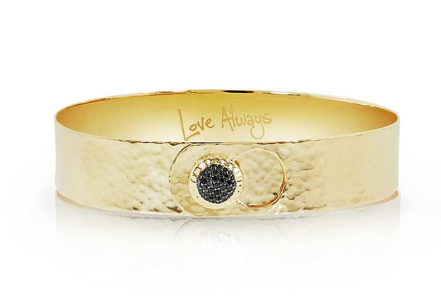Phillips House Love Always gold bracelet featuring a black diamond ($4,100).
