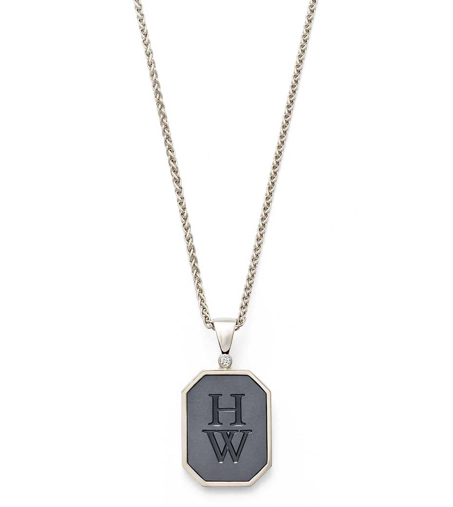 Harry Winston Zalium HW Logo pendant in white gold and Zalium, set with a round-brilliant diamond.