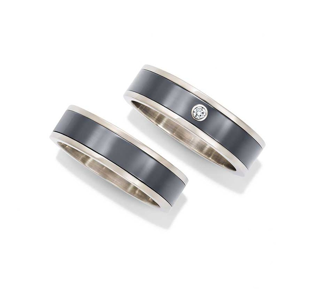 Harry Winston Zalium men's wedding bands in white gold and Zalium, with or without a round-brilliant diamond.