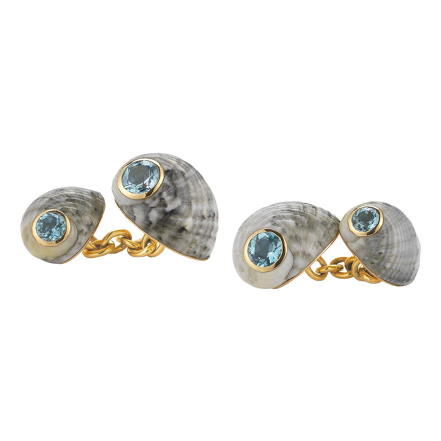 Trianon yellow gold chain-link cufflinks featuring one large and one small blue grey Nerita Chameleon shell that sit on either side of the cuff. The shells are decorated with faceted round-cut aqua blue topaz ($3,600).