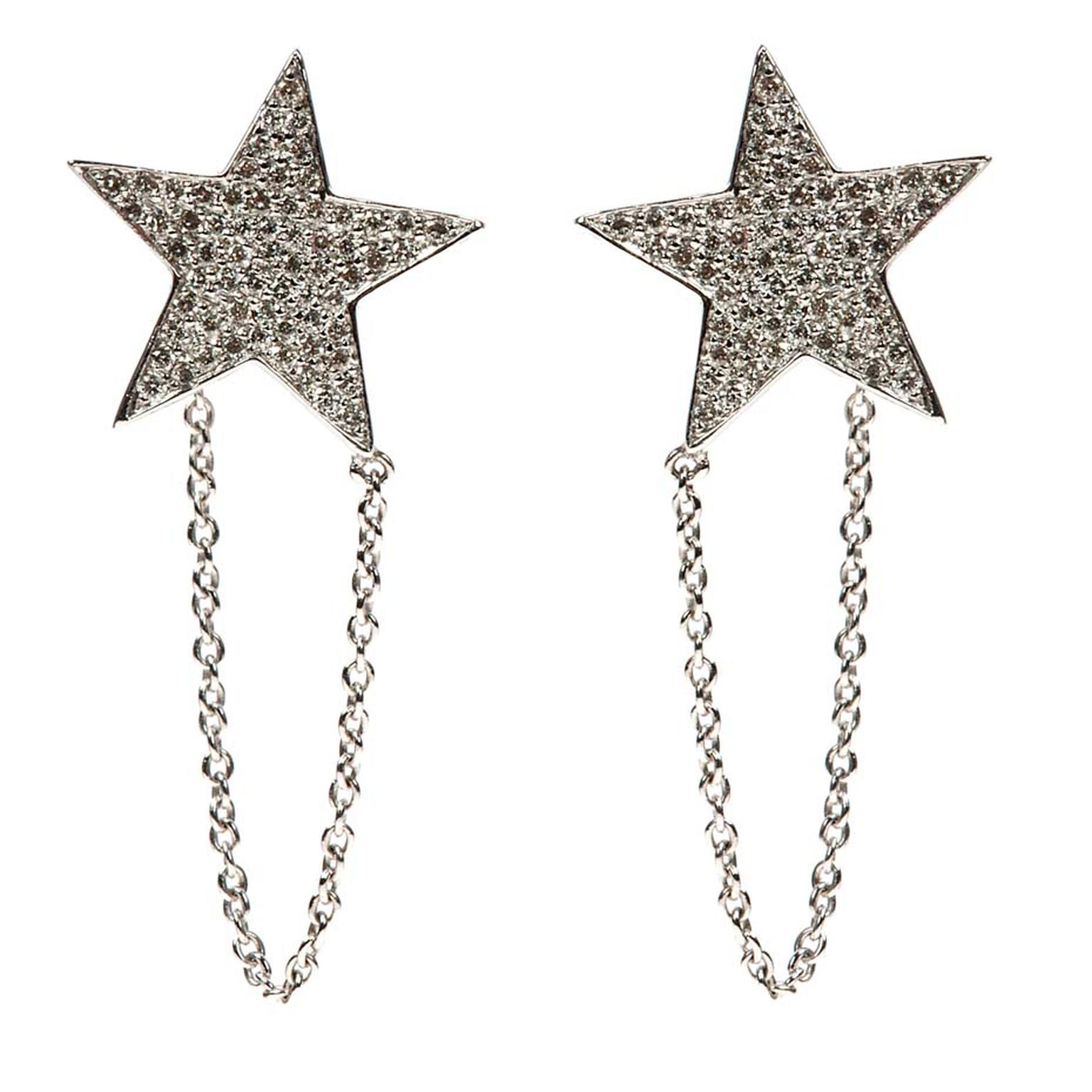 Nikos Koulis Star earrings in white gold encrusted with white diamonds can be worn in the traditional way on the ear lobe or positioned higher up on the ear.