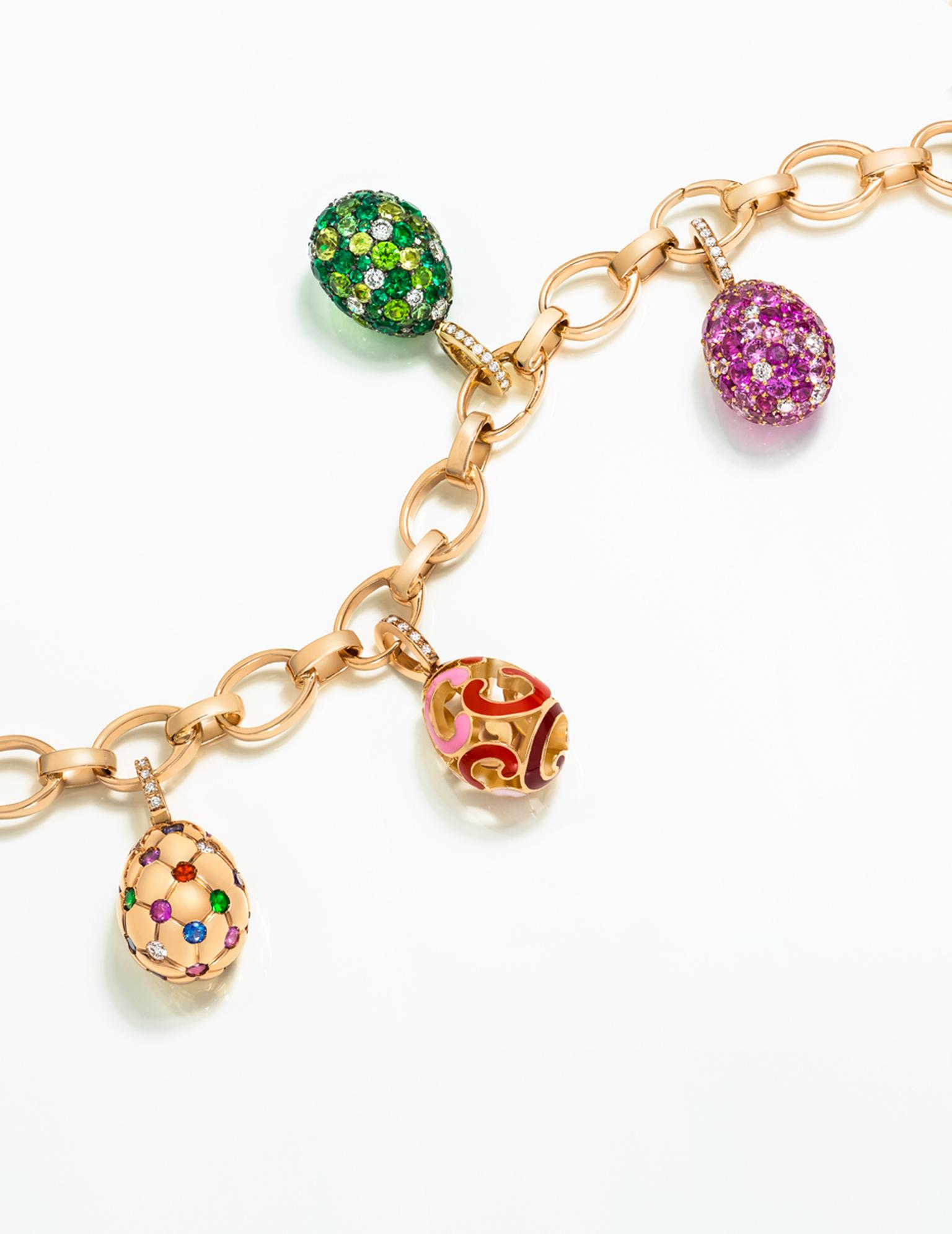 Fabergé's Egg Charms reference moments in Fabergé's history, including the Treillage egg, left, with its quilted pattern of gold dimpled with precious gemstones, which is a miniature interpretation of the 1892 Imperial Easter Egg.