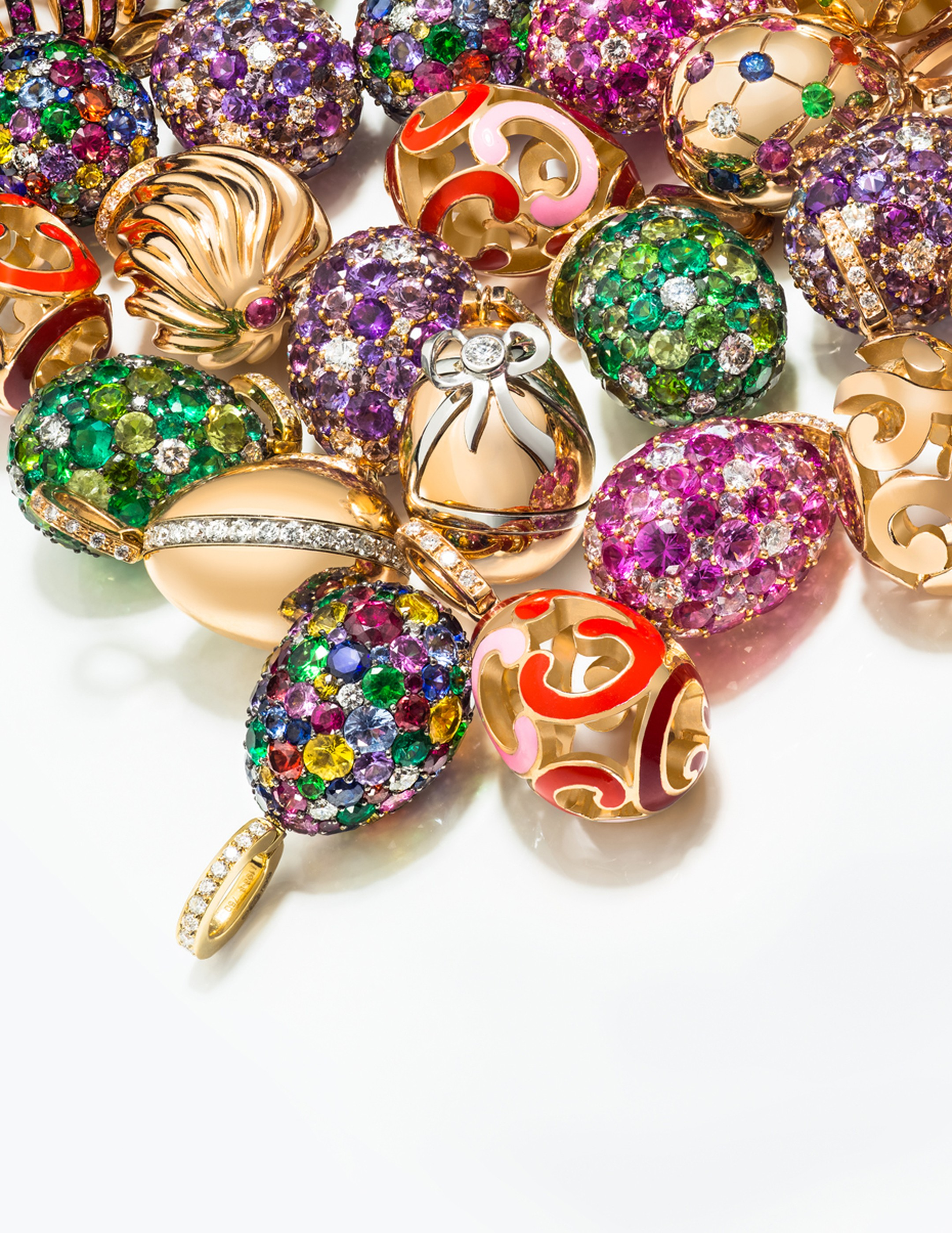 Fabergé's playful new Egg Charms, which can be fastened to a bracelet or worn on a chain around the neck, are punctuated with candy-bright gemstones, deeply ridged golden swirls or lustrous enamel.