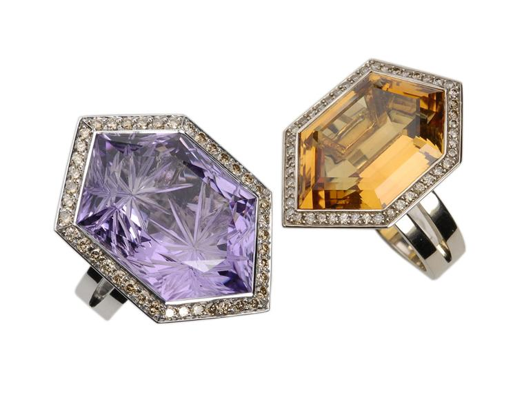 CADA Hexagon rings in white gold. The ring on the left is set with an amethyst surrounded by brown diamonds and the ring on the right features a citrine surrounded by brown diamonds.
