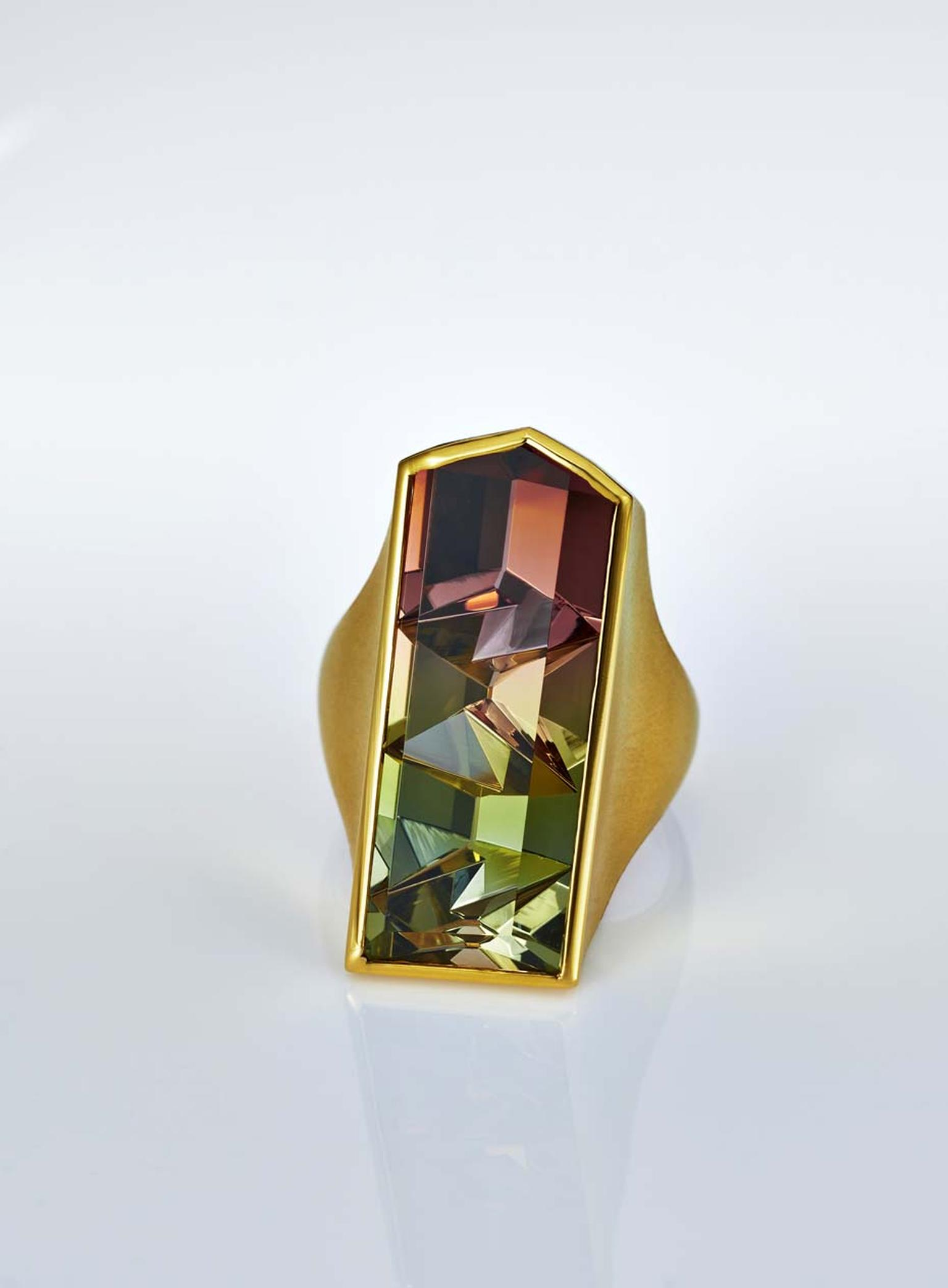 Atelier Munsteiner ring with a bi-colour tourmaline set in yellow gold.