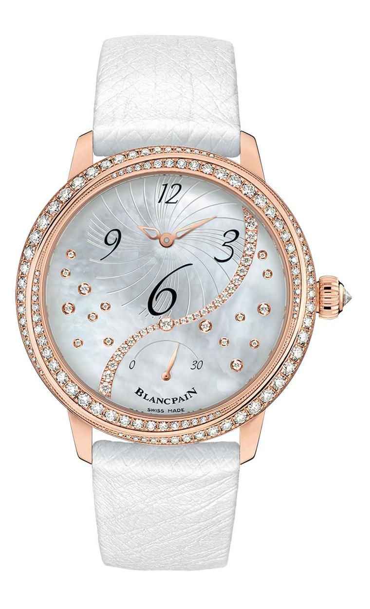 Blancpain Heure Décentrée watch comes in a 36.8mm rose gold case set with 108 diamonds and a dial featuring interwoven ribbons that embrace the contours of the case.