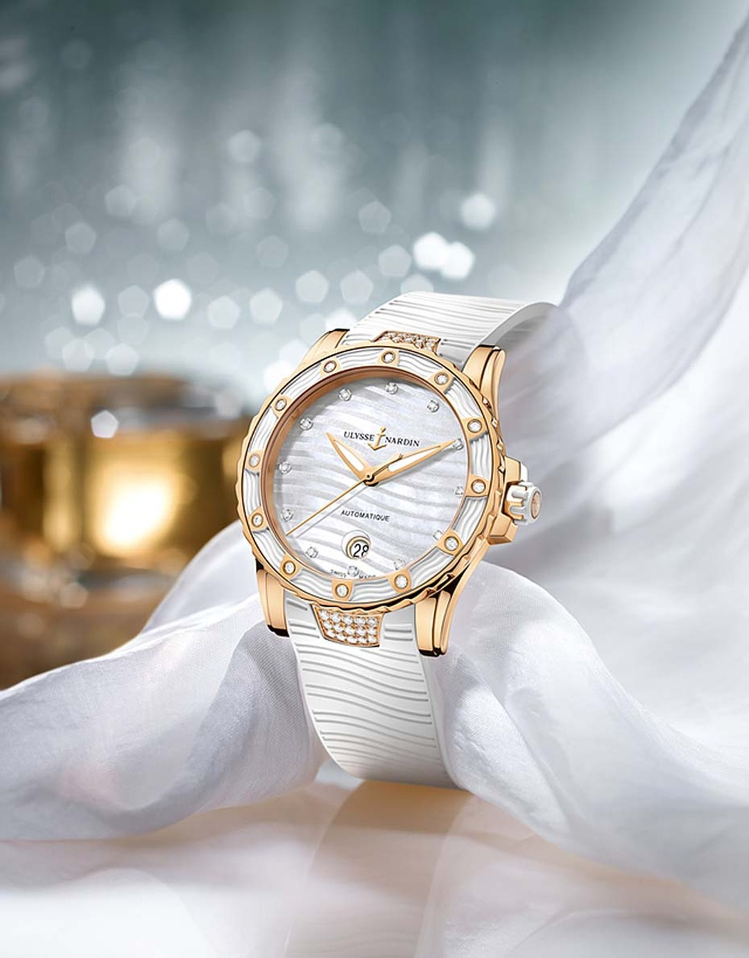 Ulysse Nardin's Lady Diver, in a 40mm rose gold case, is a dive watch capable of depths of up to 100m and is equipped with a white unidirectional rotating bezel and a screw-down safety crown.
