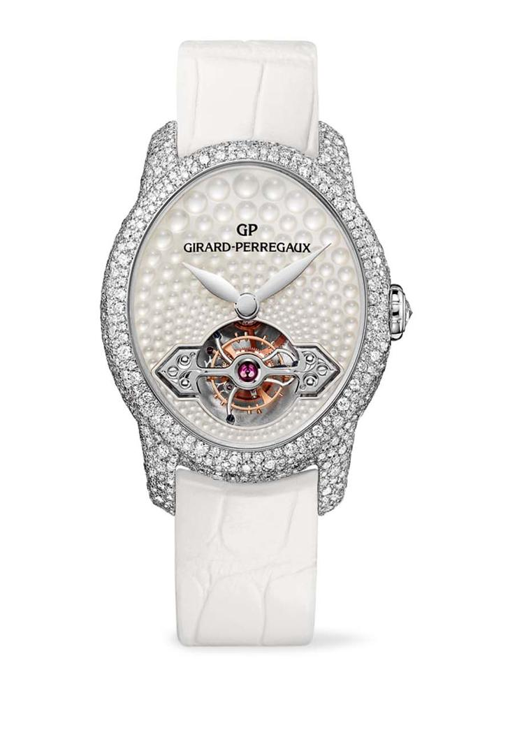 Girard-Perregaux Cat's Eye Jewellery watch glitters with over 1,000 snow-set diamonds on the white gold case, which houses a unique mother-of-pearl dial with light-reflecting bubbles across its entire surface.