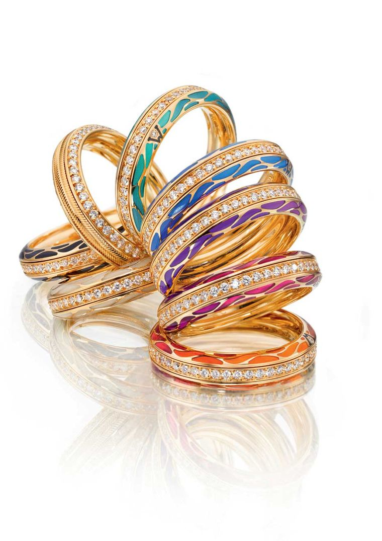 Wellendorff Genuine Delight gold rings with diamonds and coloured enamel. Each ring is comprised of three individual rings that link together to allow them to spin freely.
