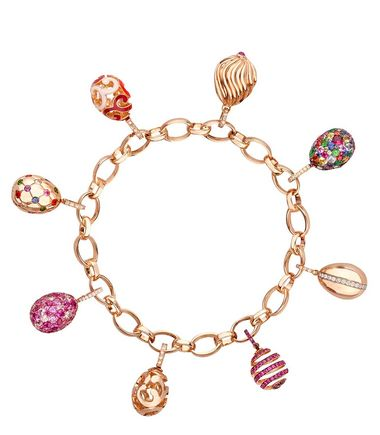 Fabergé rose gold bracelet with eight Fabergé Charms featuring sapphires, amethysts, diamonds, enamel and other coloured gemstones.